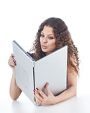 Beautiful young woman holding a laptop