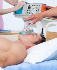 Sick patient receiving receiving oxygen