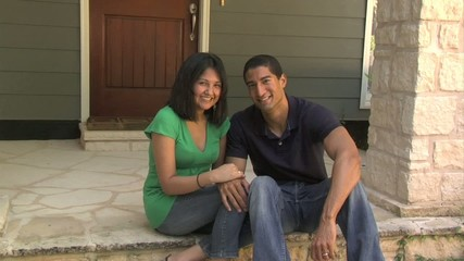 Latino couple on porch - 105