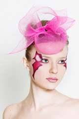 studio shot of beautiful woman with bright face art visage