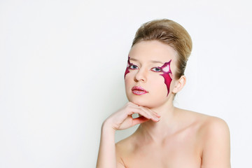 studio shot of beautiful woman with purple face art visage