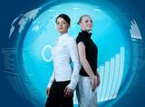Attractive couple of businesswomen in futuristic interface
