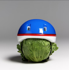 head of lettuce with a helmut