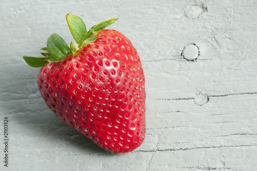 Beautiful red fresh strawberry on old gray wooden table