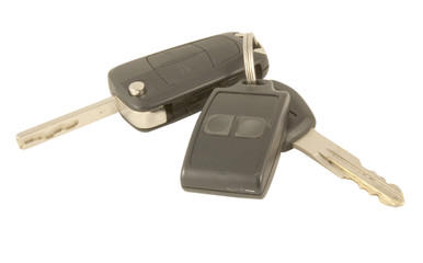 car keys and alarm fob isolated on white background