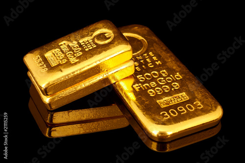 Leinwanddruck Bild Goldbarren übereinander
