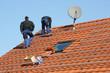 Workpeople assembling solar