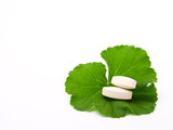 Pills of the green leaf. White background.