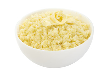 Millet porridge decorated with butter isolated