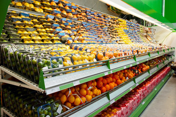 Shelf with fruits, TMs removed, price tags contain no copyright.