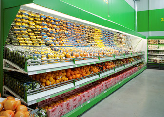 Shelf with citrus fruits in supermarket