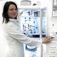 Portrait of a female researcher carrying out research experiment