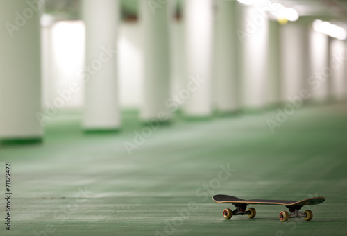 skateboard in an underground parking - perfect place for a ride.