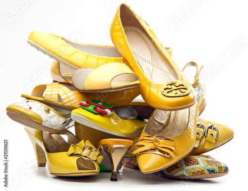 Pile of female yellow shoes
