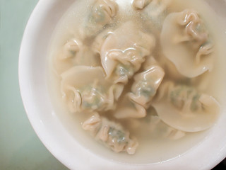 Chinese style dumplings in soup