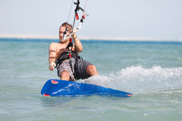 Kiteboarder enjoying surfing