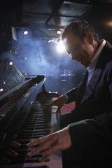 Pianist Performing in Jazz Club