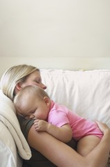 Mother and Baby Sleeping on Sofa