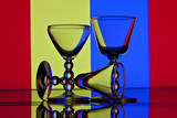 Wine glasses in front of colorful background
