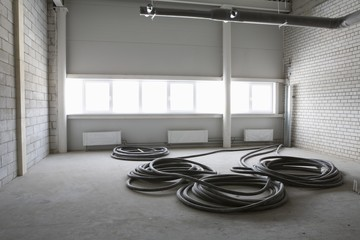 Cable wires in empty room, warehouse