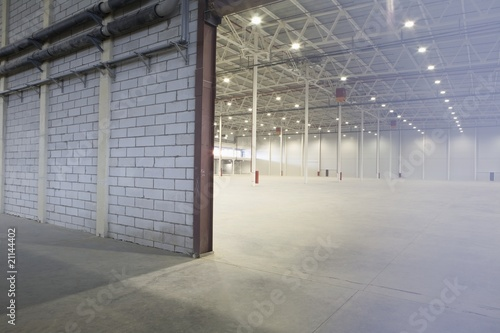 Access door to brightly lit and empty warehouse