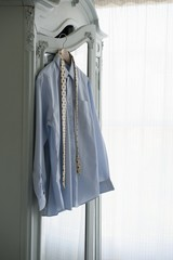 Shirt and tie hang on wardrobe