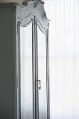 Mirrored wardrobe with heart-shaped lock and key