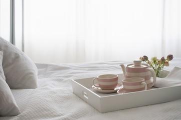 Pink striped teaset on breakfast tray