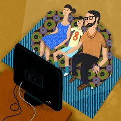 seated parents and son in the sofa watch the TV