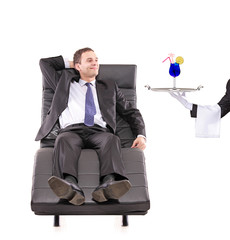 Young businessman relaxing on a sofa