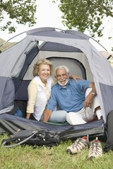 senior couple at entrance to tent
