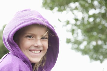 Portrait of a girl in a purple hooded top