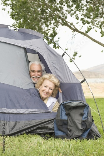 senior couple with heads at tent flap