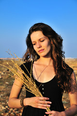 girl holding dry spikelets
