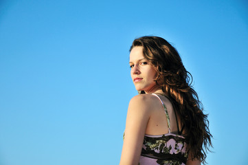 brunette longhaired girl over the blue sky