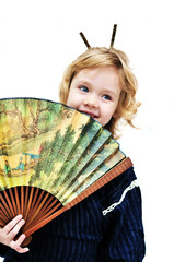 little girl holding big fan