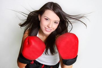 studio shot of smiiling female boxer