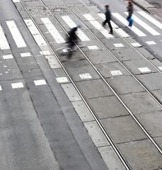 urban traffic concept - city street with a crossing, rail, motio