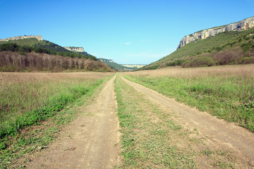 Spring Crimean mountain landscape with road in valley (Mangup Ka