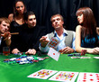 Stylish man suit folds two cards in casino poker