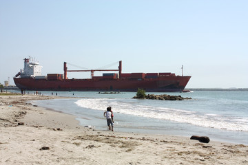 Transport ship in Caribbean beach