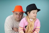 upset father and little girl posing poster