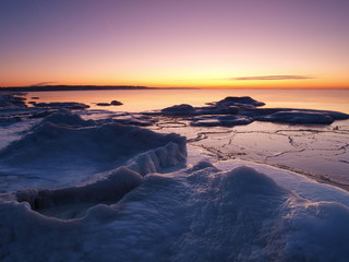 Freezing sea shore in the romantic evening light