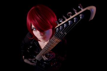 Sensual girl with guitar, high angle view