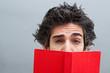 Student reading a suspense novel