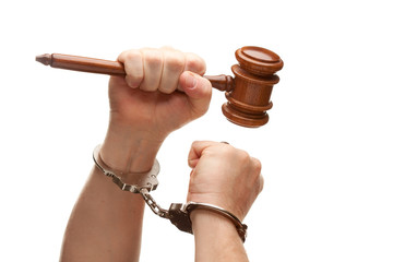 Handcuffed Man Holding Wooden Gavel on White