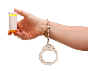 Handcuffed Man Holding Blank Medicine Bottle Isolated on White