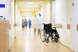 Hospital, wheelchair and unrecognizable people. poster
