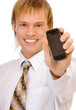 Friendly confident man holding mobile phone