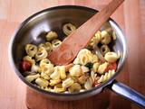 Preparing pasta dish poster